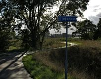 Cycling path with sign stock photography