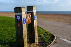 Cycling and pedestrian sign pointing to seafront road Royalty Free Stock Photography