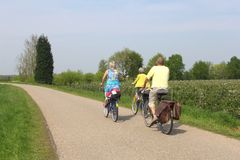 Cycling tourists in spring at the touristic Appeldijk (Apple Dike),Betuwe,Holland Stock Photo