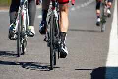 Cycling race competition on the asphalt road, view from behind Royalty Free Stock Photography