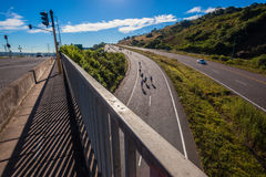Cycling Race Riders Hill Bridge Overlooking Royalty Free Stock Photo