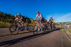 Cycling Race Tandem Teams Durban. Cycling race tandem teams pedaling hard up last hill Royalty Free Stock Photography