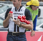 Cycling Revitalization Point Detail - Tour de France 2014. Col du Lautaret, France - July 19, 2014: Image of an unidentified man holding a cylcling bottles at a Stock Photos