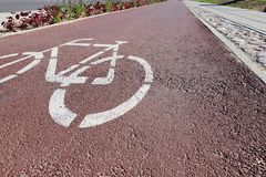 Bike sign on bicycle path. Perspective royalty free stock image