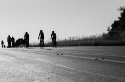 Cycling Road Silhouetted Black White. Cyclists Cycling up hill silhouetted road race Stock Photos