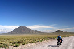 Cycling Ruta 40. Woman cycling on the famous national Ruta 40 ( quarenta ) in the remote part of central Argentinarn Royalty Free Stock Images