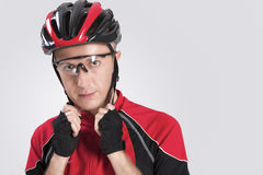 Cycling Safety Concept and Ideas. Portrait of Male Caucasian Cyclist Putting On Helmet. Stock Photography