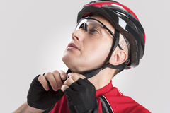 Cycling Safety Concept and Ideas. Portrait of Male Caucasian Cyclist Putting On Helmet. Stock Photo