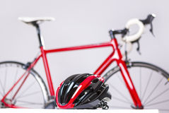 Cycling Safety Concept. Road Bike Protection Helmet in Front of Professional Road Bike. Royalty Free Stock Photography