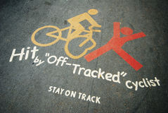 Cycling safety signs. Safety sign for bicyclists on the road to warn them to stay on track Stock Photos