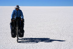 Cycling on the salar Royalty Free Stock Image