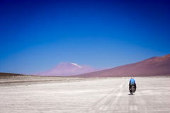 Cycling on the salar Royalty Free Stock Images
