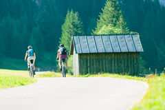 Cycling Senior Couple Stock Photo