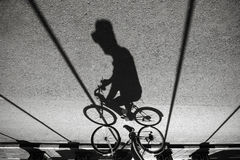 Cycling. Shadow of a man cycling on Malioboro Street, Yogyakarta Stock Photography