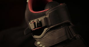 Cycling shoe. On a black background Stock Photos