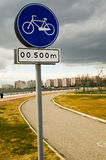 Cycling sign with bike track in the urban. Cycling sign with bike track in the city Royalty Free Stock Image