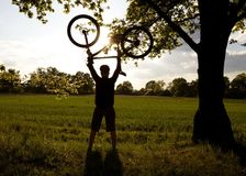Cycling silhouette and success Royalty Free Stock Images