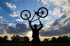 Cycling silhouette sunset and success Stock Photography