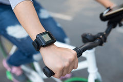 Cycling with smart watch Royalty Free Stock Photo