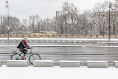 Cycling in the snow Royalty Free Stock Photography
