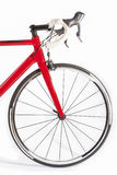 Cycling Sport Concept. Professional Road Bike Front Wheel and Handlebars Closeup. Against White. Vertical Image Stock Image