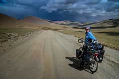 Cycling through the stunning Tibetan landscape Royalty Free Stock Images