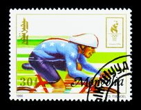 Cycling, Summer Olympics 1996, Atlanta serie, circa 1996. MOSCOW, RUSSIA - NOVEMBER 26, 2017: A stamp printed in Mongolia shows Cycling, Summer Olympics 1996 Stock Images