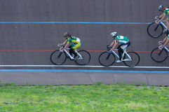 Cycling team comes to turn on the track. Cyclist in training. Gr. Girls team of cyclists comes to the turn of the track. Cyclist in training. Group Check Royalty Free Stock Photo