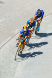 Cycling team racing on velodrome Royalty Free Stock Images