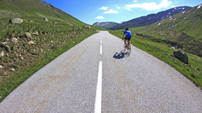 Cycling, to the summit. French Alps. stock image