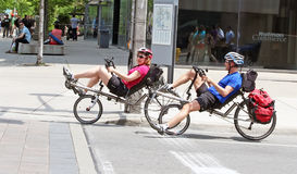 Cycling in Toronto. Two cyclists riding recumbent bikes in downtown Toronto Royalty Free Stock Images