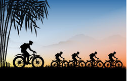 Cycling touring group. Illustration, Sunset Mountain Scene, Variable in AI file Royalty Free Stock Photos