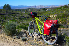 Cycling tourism MTB bike in Pedralba Valencia with panniers Royalty Free Stock Image