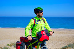 Cycling tourist cyclist in Mediterranean beach Stock Images