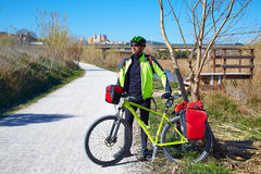 Cycling tourist cyclist in Ribarroja Turia with paniers Royalty Free Stock Images