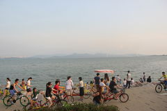 Cycling tourists on the beach in SHENZHEN CHINA ASIA Royalty Free Stock Photo