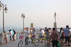 Cycling tourists on the beach in SHENZHEN CHINA ASIA Stock Images