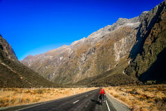 Cycling towards Milford Sound Stock Photos
