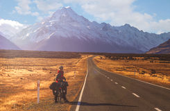 Cycling towards Mount Cook Royalty Free Stock Photo