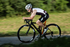 Cycling triathlete in blurred motion Stock Images