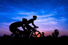Cycling on twilight time Royalty Free Stock Image
