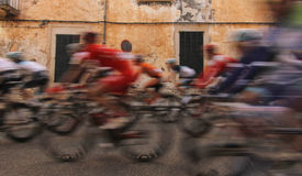 Cycling in the village. The pack of riders takes part in a leg near the village of felanitx during the challenge tour of mallorca cycling race Royalty Free Stock Photos