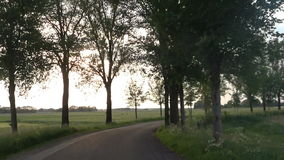 Cycling on a winding country road stock footage