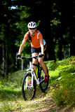 Cycling woman. A cycling woman in front of forest Stock Photos