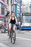 Cycling women in Amsterdam. AMSTERDAM-AUG. 19, 2012. Cycling women on Aug. 19 in Amsterdam. 38% of traffic movement in the city is by bike , 37% by car, 25% by Royalty Free Stock Photo