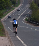 Cyclist. Lonely cyclist on the road Stock Photo