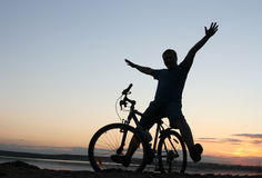 Cyclist. Raises his hands at sunset Stock Photo