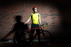 A cyclist. Bold image of a cyclist with his bike Stock Photography
