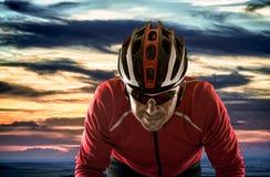 Cyclist. With helmet against cloudy sunset sky stock photo
