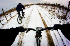Cyclist. Two men ride mountain bikes, p.o.v winter ride Royalty Free Stock Photos